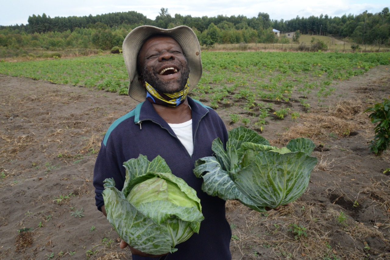 Isaac Buthelezi with his bean field in the background