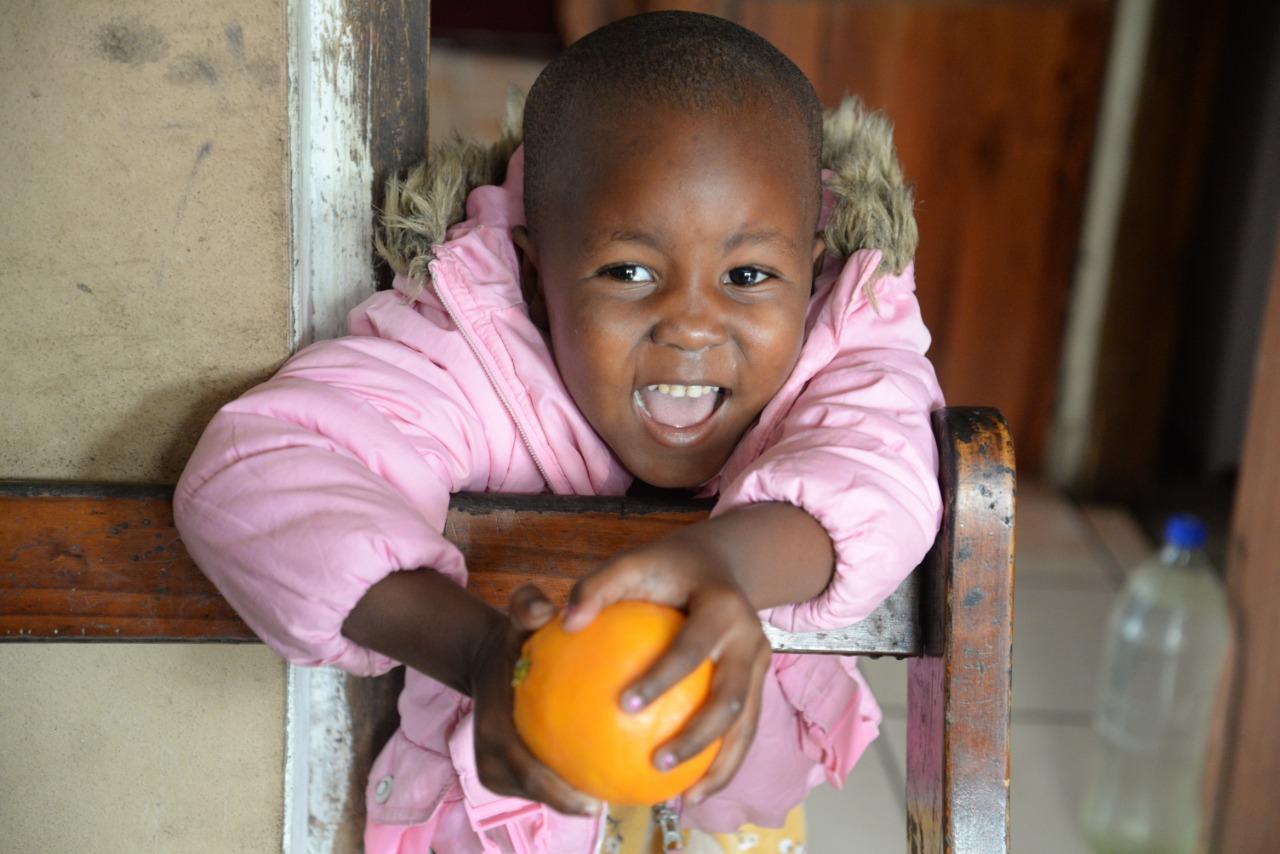 Nkazi Sibaya enjoys an orange
